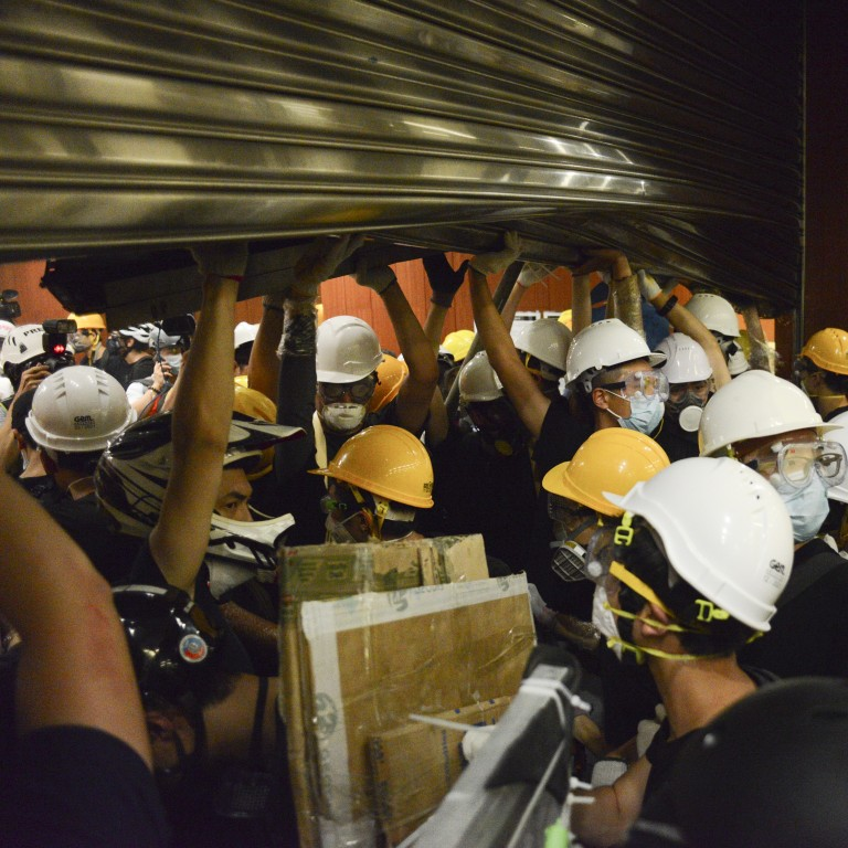 b7de3791 Protesters storm the Legislative Council Chamber in Tamar, Hong Kong during  a protest against the