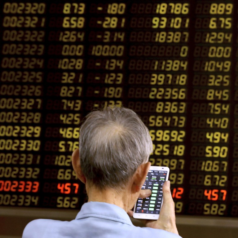 04475755 A man monitors stock prices at a brokerage in Beijing on Tuesday, June 25,