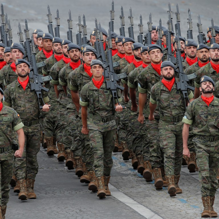 Spanish soldiers march during the traditional Bastille Day military parade on the Champs-Elysees Avenue in Paris. Photo: Reuters