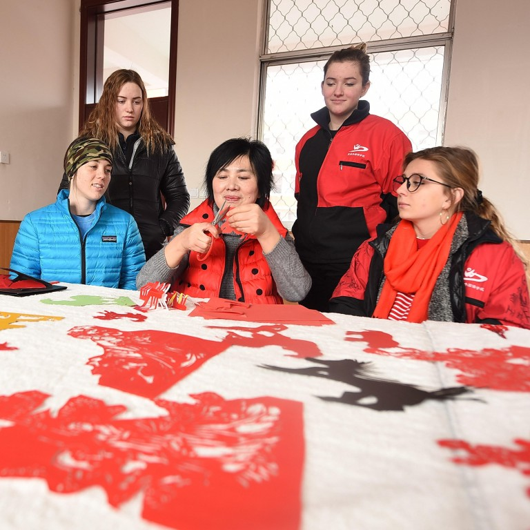 International students in China experience the traditional art of paper-cutting as part of their introduction to Chinese culture. Province. Photo: Alamy