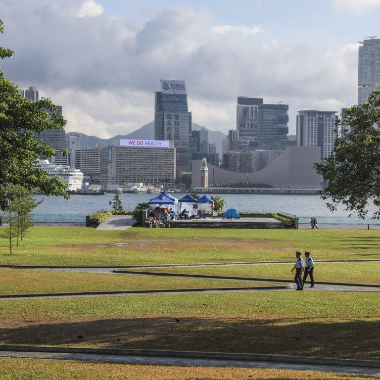 525432191466b Police patrol Tamar Park after anti-extradition protests, on June 18.  Whether acceptance