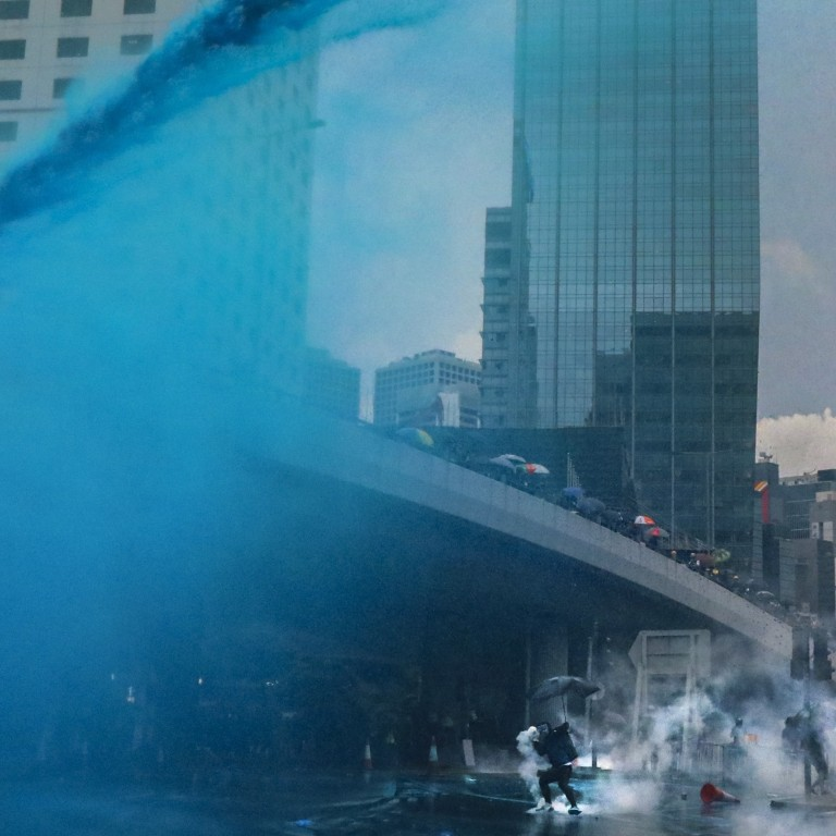 Indelible blue dye fired from water cannons by Hong Kong
