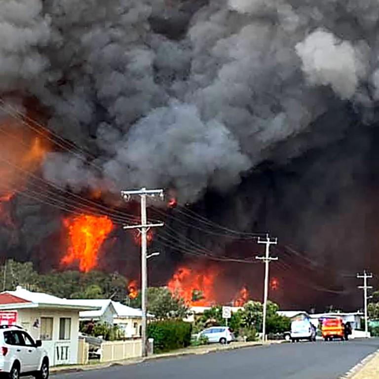 bush fires tear through eastern australia  leaving at least three dead and 150 homes razed