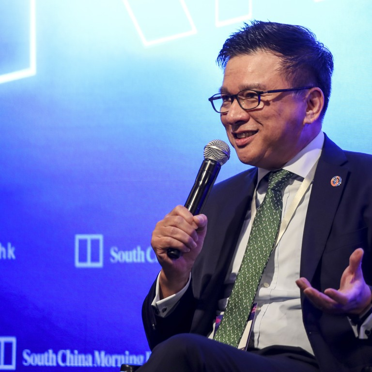 """Chan Ka-keung, chairman of WeLab virtual bank, speaking at the """"Redefining Hong Kong Forum"""" in Admiralty on Wednesday. Photo: Xiaomei Chen"""