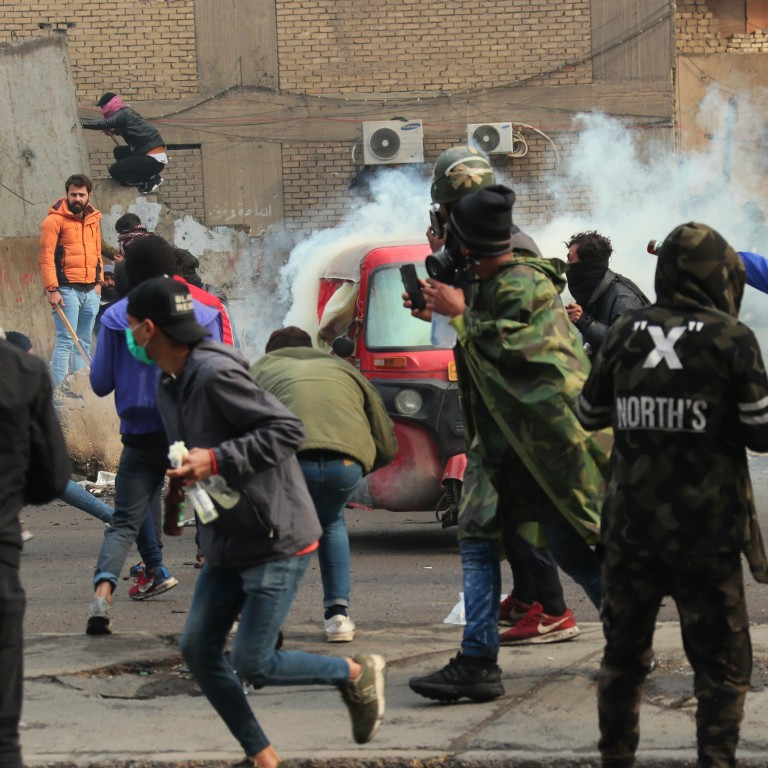 Image result for IRAQ PROTESTS SECURITY FORCES FIRE AT DEMONSTRATORS AT BAGHDAD'S MAIN CAMP