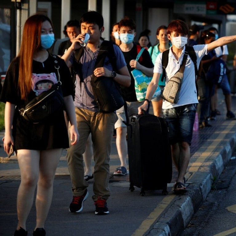 Coronavirus Malaysian Workers In Singapore In A Quandary After