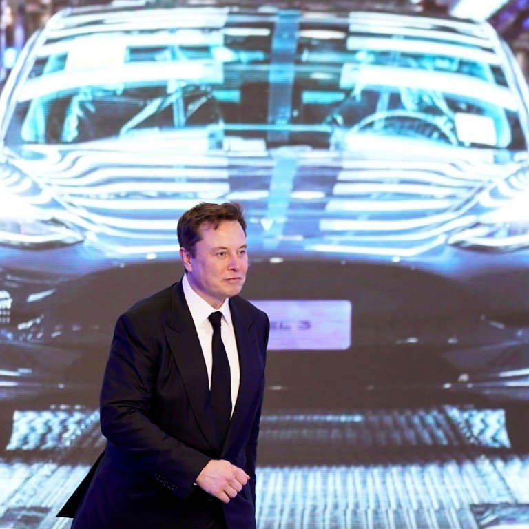 Tesla Inc CEO Elon Musk walks next to a screen showing an image of Tesla Model 3 car during an opening ceremony for Tesla China-made Model Y program in Shanghai, China January 7, 2020. Photo: Reuters