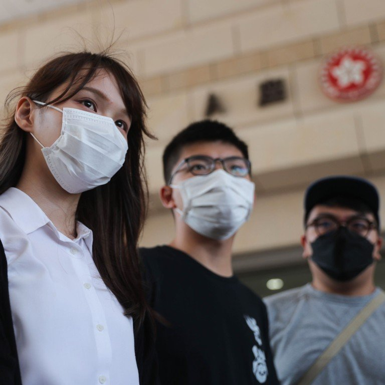 Agnes Chow, Joshua Wong and Ivan Lam arrive at West Kowloon Court on Wednesday. Photo: Sam Tsang