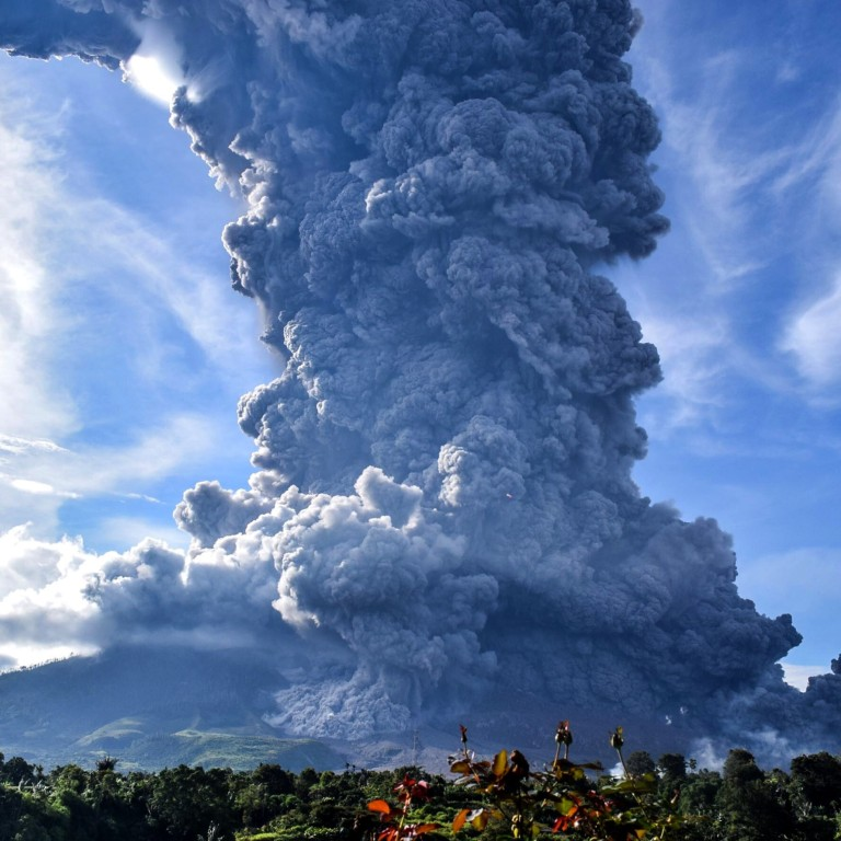 Indonesia's Sinabung volcano erupts, ejecting towering column of ...