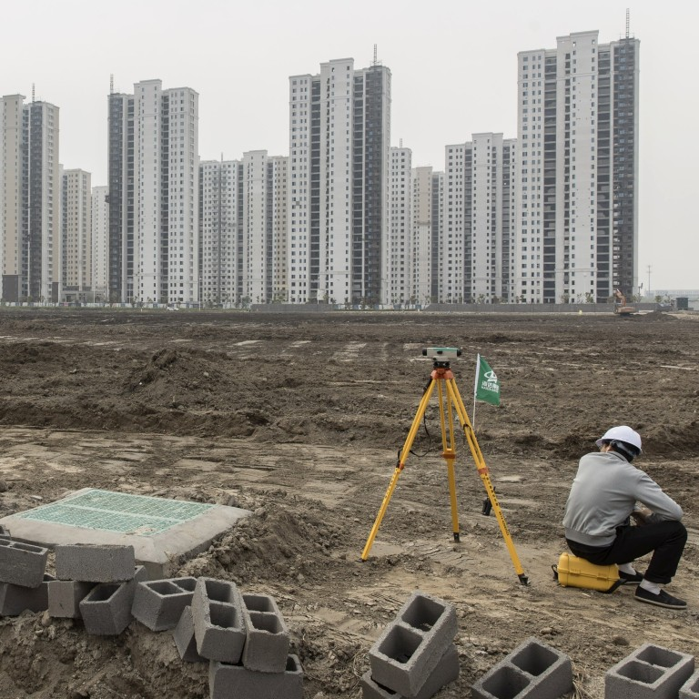 A surveyor sits on a construction site in Ningbo, China, on April 26, 2020. Local governments have long offered firms connected to China's political elite land sale discounts. Photo: Bloomberg