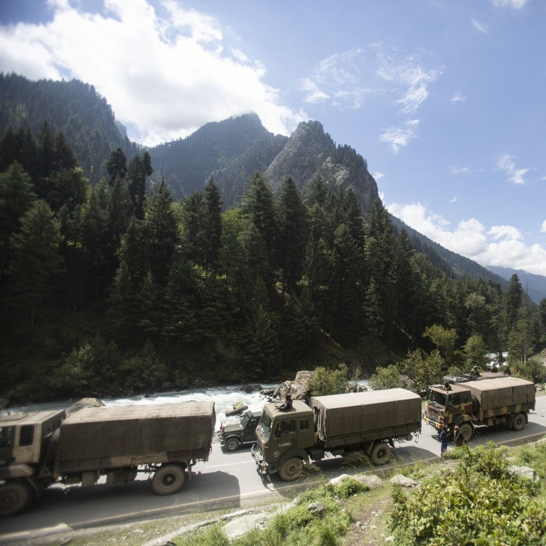 """An Indian army convoy travels along the Srinagar-Ladakh highway at Gagangeer in Kashmir on Tuesday. India says its soldiers thwarted """"provocative"""" movements by China's military near their disputed border in Ladakh. Photo: AP"""