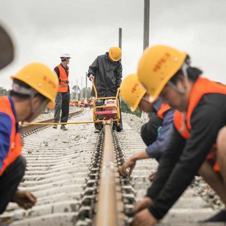 Workers weld the first seamless rails for the China-Laos railway, in Vientiane, on June 18, 2020. Photo: Xinhua