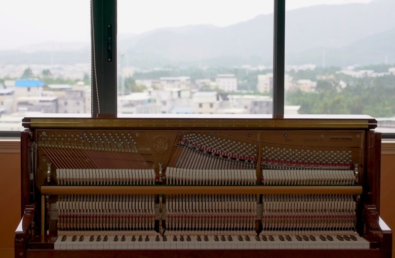 Inside the world's biggest piano factory
