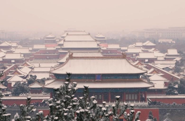 Snowfall blankets the Forbidden City