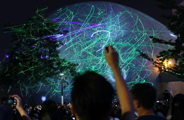 Hundreds protest student arrest with laser show