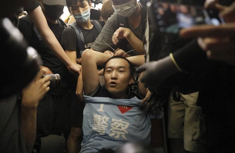 Chinese reporter beaten in Hong Kong gets cash reward