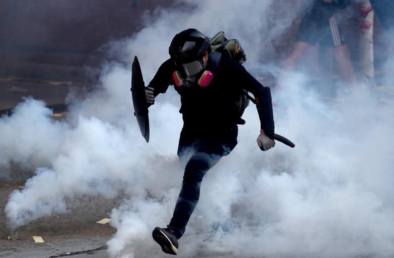 Hong Kong to ban masks at protests