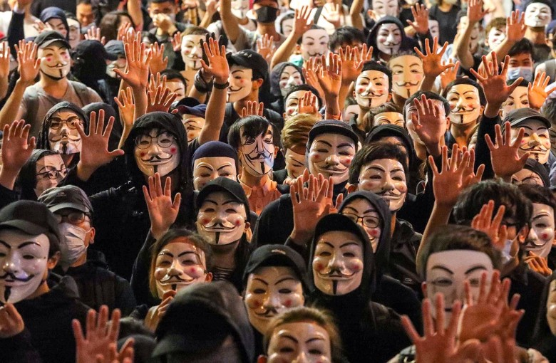 Hundreds in Hong Kong don Guy Fawkes masks in protest