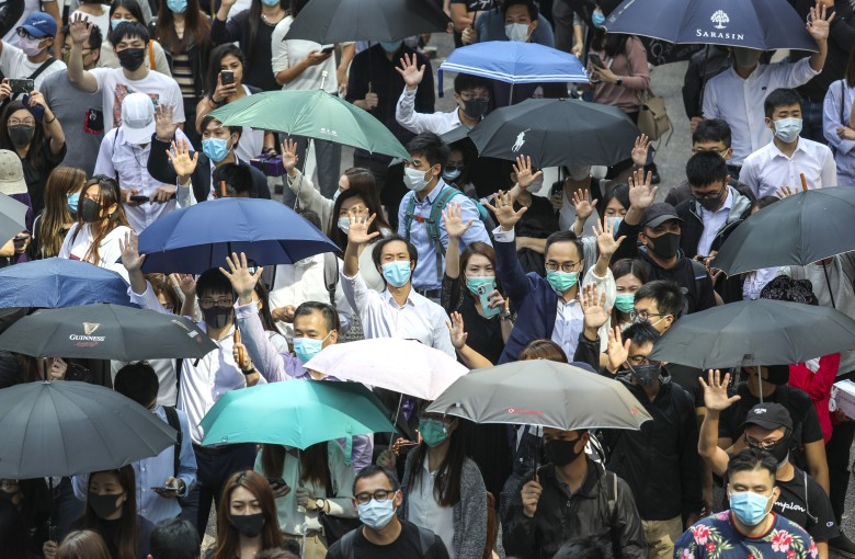 Office workers join Hong Kong's protests in shirts and heels