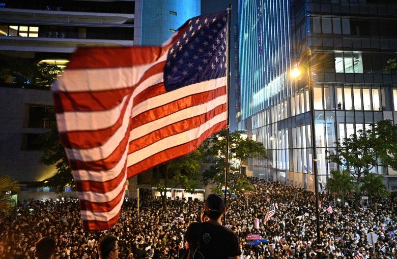 Hong Kong democracy bill clears hurdle as city fights 'for their lives'