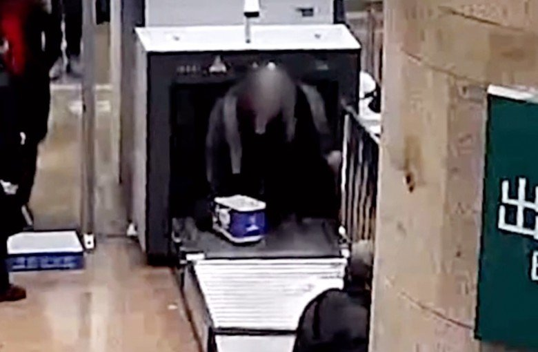 Man in China climbs into baggage scanner to avoid taking off his bag