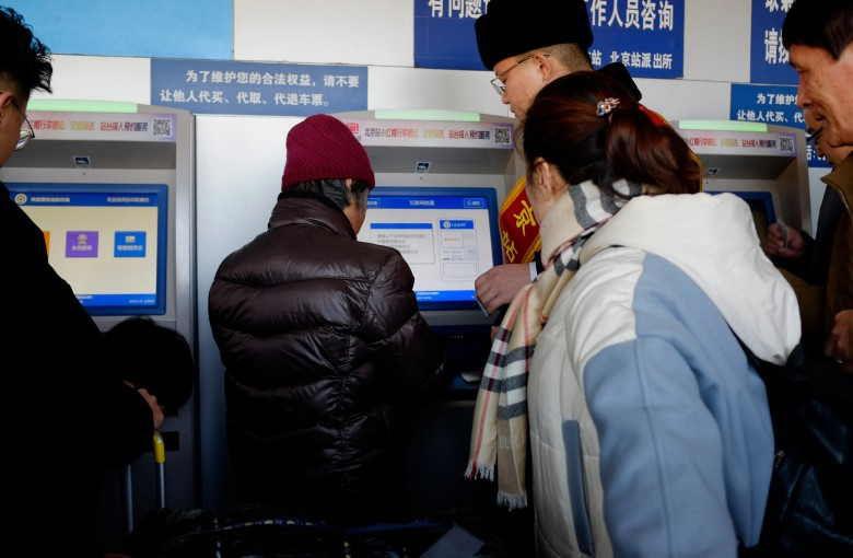 China's high-speed trains go ticket-less to aid New Year's travelers