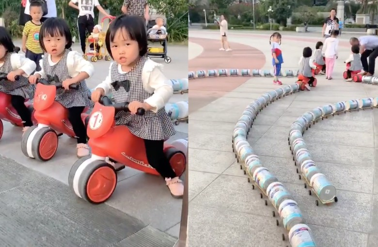 Father in China builds 'train' of empty milk-powder cans