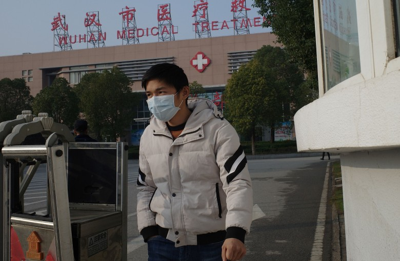 China says new virus can spread between humans as travel season looms