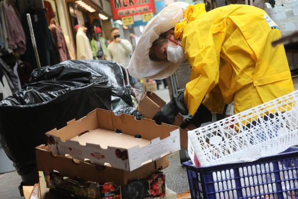 "A woman collects cardboard in Mong Kok on February 13, 2020. The city's poor deserve better than ""loyal rubbish"". Photo: K.Y. Cheng"