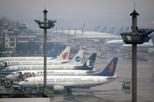Passenger jets are parked at the Baiyun International Airport in Guangzhou. Photo: Reuters