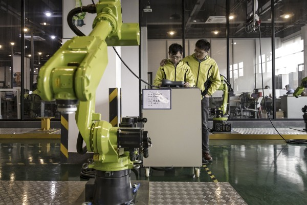 Technicians work at E-Deodar Robot Equipment's factory in Foshan. The Greater Bay Area city has come up with incentives to draw start-ups and skilled workers. Photo: Bloomberg