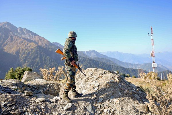 An Indian Army soldier stands guard near the border with Pakistan. Photo: AFP