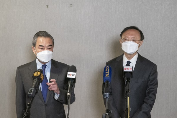 Foreign minister Wang Yi (left) and foreign policy chief Yang Jiechi speak to the media following the end of the meeting with the United States in Anchorage, Alaska, on March 19. Photo: Xinhua