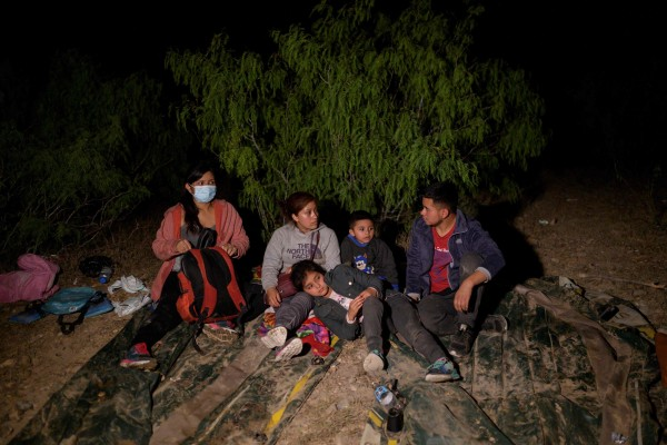 Immigrants from Guatemala, who arrived illegally across the Rio Grande river from Mexico, rest on the US side of the river bank. Photo: AFP