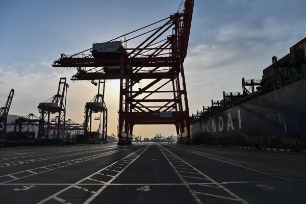 General view shows a cargo ship and cranes at the Lianyungang port container terminal in Lianyungang, Jiangsu province, China on March 24. Photo: AFP
