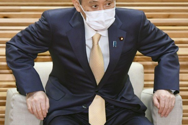 Japan's Prime Minister Yoshihide Suga attends a cabinet meeting at his office in Tokyo on Friday. Photo: Kyodo