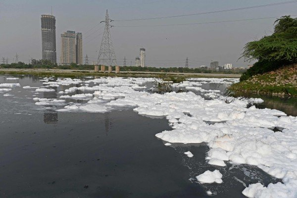 A view of the river Yamuna half covered with foam due to pollution in New Delhi. Photo: AFP