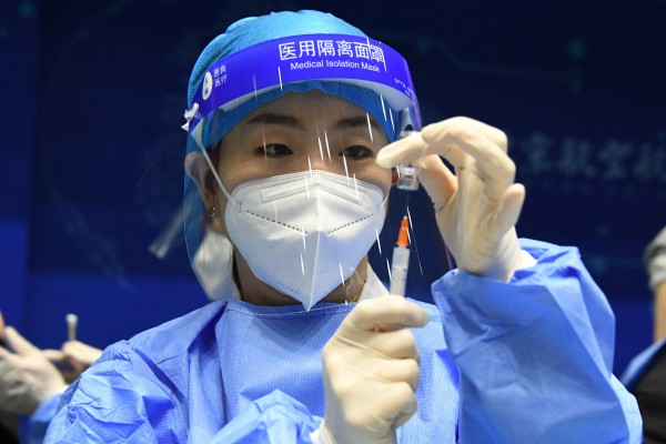 Beijing is expanding the vaccination programme to include residents who are from Hong Kong and Macau as well as people over 60. Photo: Xinhua