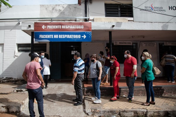 People wait to receive a vaccine shot at a hospital in Asuncion, Paraguay. Photo: Bloomberg