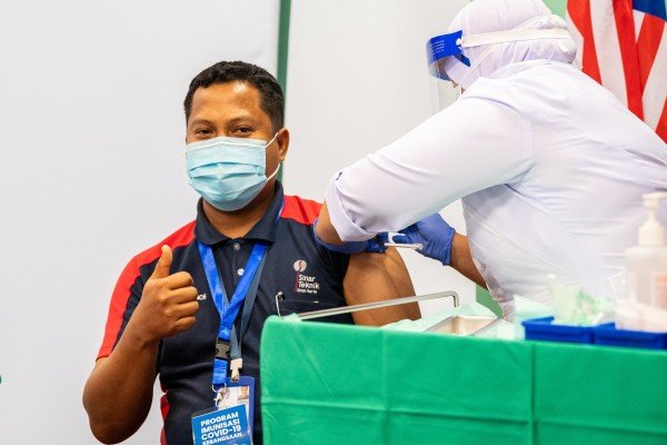 A man receives a dose of Sinovac's Covid-19 vaccine at a hospital in Malaysia in March. Photo: Xinhua
