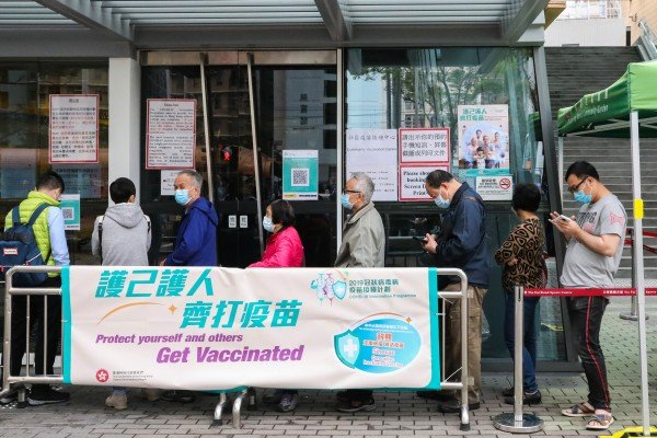 People queue to get the Sinovac vaccine at Tin Fai Road Sports Centre in Tin Shui Wai. Photo: K.Y. Cheng