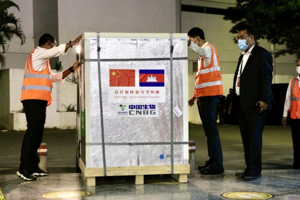 Workers unload Sinopharm vaccines at the Phnom Penh airport in March. Cambodia is one of more than 60 countries to receive vaccines from China. Photo: Xinhua