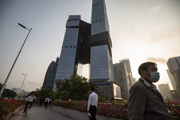 People walk along a pedestrian walkway near the Tencent Holdings headquarters in Shenzhen on March 20. Photo: Bloomberg