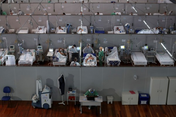 Health workers treat Covid-19 patients at a field hospital in a sports gym in Santo Andre, on the outskirts of Sao Paulo, Brazil. Photo: Reuters