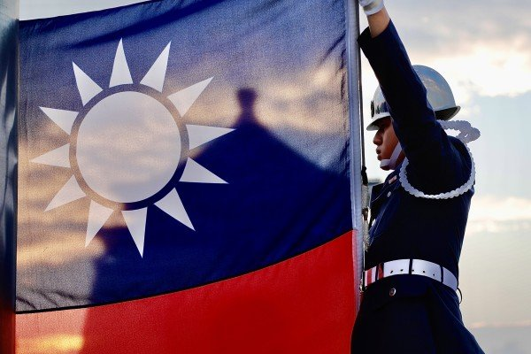 A member of the Taiwanese guard of honour raises the island's flag at Liberty Square in November. Photo: DPA
