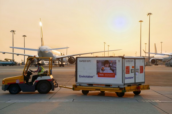 Containers carrying Sinovac's Covid-19 vaccine are unloaded from a Cathay Pacific plane at the Hong Kong International Airport on February 19. Photo: Handout