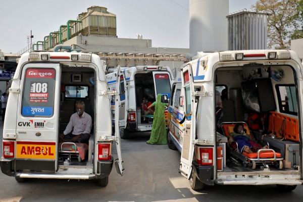 Patients with breathing problems wear oxygen masks as they wait inside ambulances in a queue to enter a Covid-19 hospital in Ahmedabad, India, on April 14. Photo: Reuters
