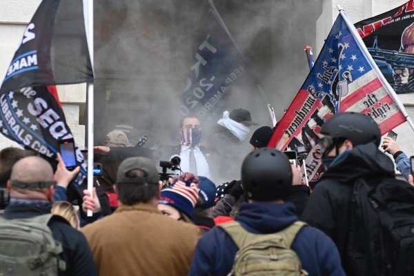 Trump supporters are tear gassed outside the US Capitol in January. Photo: TNS