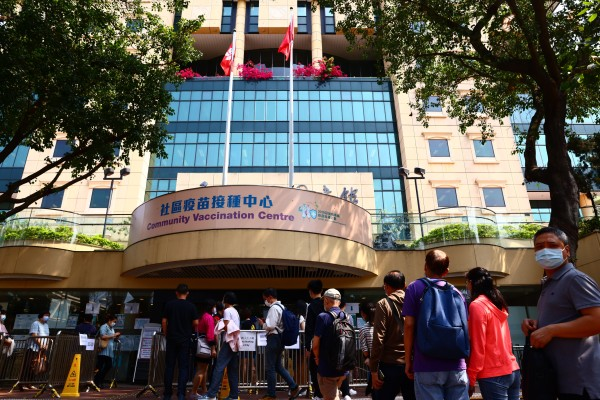 People queue for the Sinovac vaccine at Hong Kong Central Library, in Causeway Bay. Photo: Nora Tam