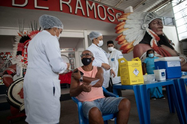 Chinese company Sinovac's Covid-19 vaccine is administered to a man in Rio de Janeiro, Brazil. Photo: AFP